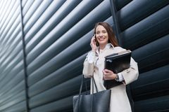Portrait of young beautiful businesswoman going to office Royalty Free Stock Photography
