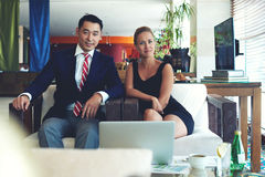 Portrait of a young successful business men and woman working together on common projects Royalty Free Stock Photo