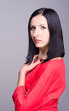 Portrait of young successful business woman. On a grey background Royalty Free Stock Photography