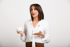Portrait of young successful business woman over white backgroun. Portrait of young successful business woman, gesturing, holding cup of coffee, over white Stock Photos