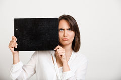 Portrait of young successful business woman over white backgroun. Portrait of young successful business woman holding folder over white background. Copy space Royalty Free Stock Photography