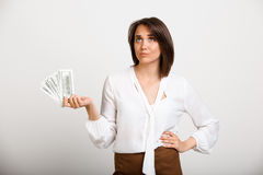 Portrait of young successful business woman over white backgroun. Portrait of young successful business woman, holding money, over white background Royalty Free Stock Photography