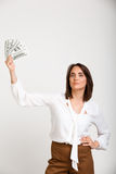 Portrait of young successful business woman over white backgroun. Portrait of young successful business woman looking at camera, holding money, over white Stock Photography
