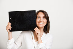 Portrait of young successful business woman over white backgroun. Portrait of young successful business woman smiling, holding folder over white background. Copy Royalty Free Stock Photos