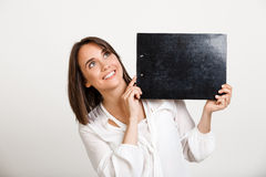 Portrait of young successful business woman over white backgroun. Portrait of young successful business woman smiling, holding folder over white background. Copy Stock Photography