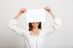 Portrait of young successful business woman over white backgroun. Portrait of young successful business woman smiling, holding paper over white background. Copy Stock Photography