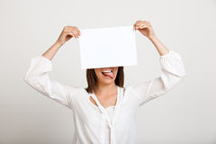 Portrait of young successful business woman over white backgroun. Portrait of young successful business woman smiling, holding paper over white background. Copy Royalty Free Stock Photo