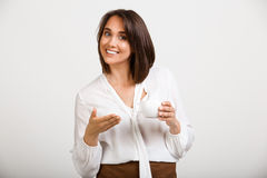 Portrait of young successful business woman over white backgroun. Portrait of young successful business woman, smiling, looking at camera, holding cup of coffee Stock Images