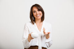 Portrait of young successful business woman over white backgroun. Portrait of young successful business woman, smiling, looking at camera, holding cup of coffee Royalty Free Stock Image