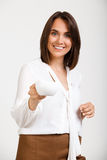Portrait of young successful business woman over white backgroun. Portrait of young successful business woman, smiling, looking at camera, holding cup of coffee Royalty Free Stock Photos
