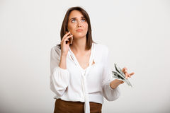 Portrait of young successful business woman over white backgroun. Portrait of young successful business woman solving problems on phone over white background Royalty Free Stock Images