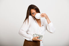 Portrait of young successful business woman over white backgroun. Portrait of young successful business woman solving problems on phone, drinking coffee, over Royalty Free Stock Photo