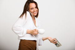 Portrait of young successful business woman over white backgroun. Portrait of young successful business woman solving problems on phone, smiling over white Royalty Free Stock Images