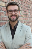 Portrait of young successful businessman with glasses outside of the office Royalty Free Stock Photos