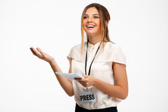 Portrait of young successful businesswoman over white background. Royalty Free Stock Image