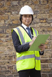 Portrait of young supervisor holding clipboard at construction site Royalty Free Stock Photos