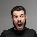 Portrait of a young surprised businessman with Royalty Free Stock Image
