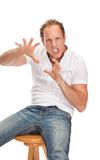 Portrait of young surprised man gesturing. Stock Photography