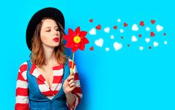 Woman with red pinwheel with hearts stock photography
