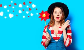 Woman with red pinwheel with hearts stock image