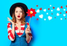 Woman with red pinwheel with hearts royalty free stock photo