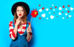 Woman with red pinwheel with hearts Royalty Free Stock Image