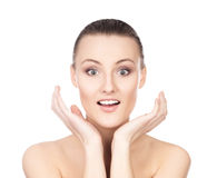 Portrait of a young and surprised woman on white Royalty Free Stock Photos
