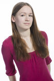 Portrait of young teen girl with long hair in pink Royalty Free Stock Photography