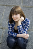 Portrait of young teen girl sitting Royalty Free Stock Photos