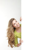 Portrait of a young teenage girl near a banner Royalty Free Stock Image