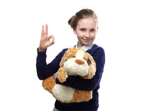 The portrait of young teenage girl with a toy  on white background Stock Photos