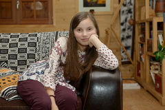 Portrait of a young teenager sitting on sofa. Portrait of a young  smiling teenager sitting on sofa Royalty Free Stock Photo