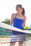 Portrait of  young tennis player on the court Royalty Free Stock Photo