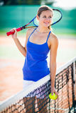 Portrait of  young tennis player on the court Royalty Free Stock Images