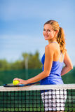 Portrait of  young tennis player on the court Stock Photo