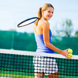 Portrait of  young tennis player on the court Stock Images
