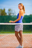 Portrait of  young tennis player on the court Royalty Free Stock Photography