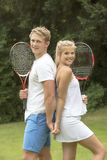 Portrait of young tennis players. TEENAGE TENNIS PLAYERS - A portrait of two young tennis players with their racquets Stock Photography