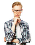 Portrait of the young thinking man with hand near face Stock Photography