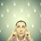 Portrait of the young  thinking woman looks up. Stock Image