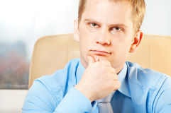 Portrait of a young thoughtful businessman. In doubt about something royalty free stock photos
