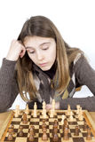Portrait Of Young Thoughtful Girl Holding Head With Hand While Playing Chess Game Isolated On White Stock Photo