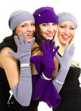 Three women in white knit wool hat and mittens Stock Photography