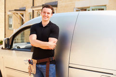 Portrait of a young tradesman by his van Stock Images