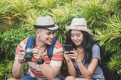 young travellers taking a rest on the side of the road during su royalty free stock photo