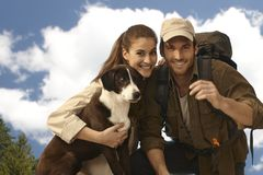 Portrait of young trekker couple with dog Stock Photography