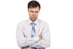 Portrait of young unhappy businessman with arms folded Royalty Free Stock Photography