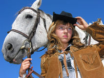 Portrait of young unhappy cowgirl with horse Stock Image