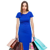 Portrait of young unhappy woman with shopping bags. Isolated over white background Stock Photo
