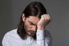 Portrait of a young upset man Royalty Free Stock Image